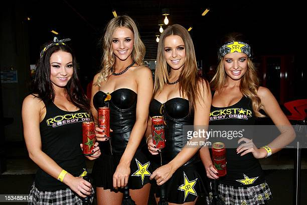Grid girls pose in the pit paddock prior to the Top 10 shootout for the Bathurst 1000 which is round 11 of the V8 Supercars Championship Series at...