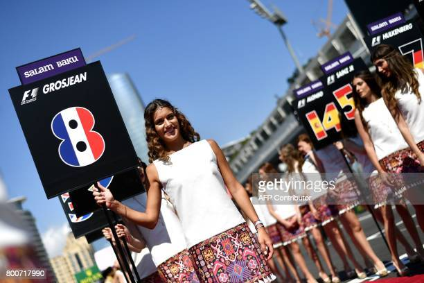 Grid girls pose prior to the drivers' parade ahead of the Formula One Azerbaijan Grand Prix at the Baku City Circuit in Baku on June 25 2017 / AFP...