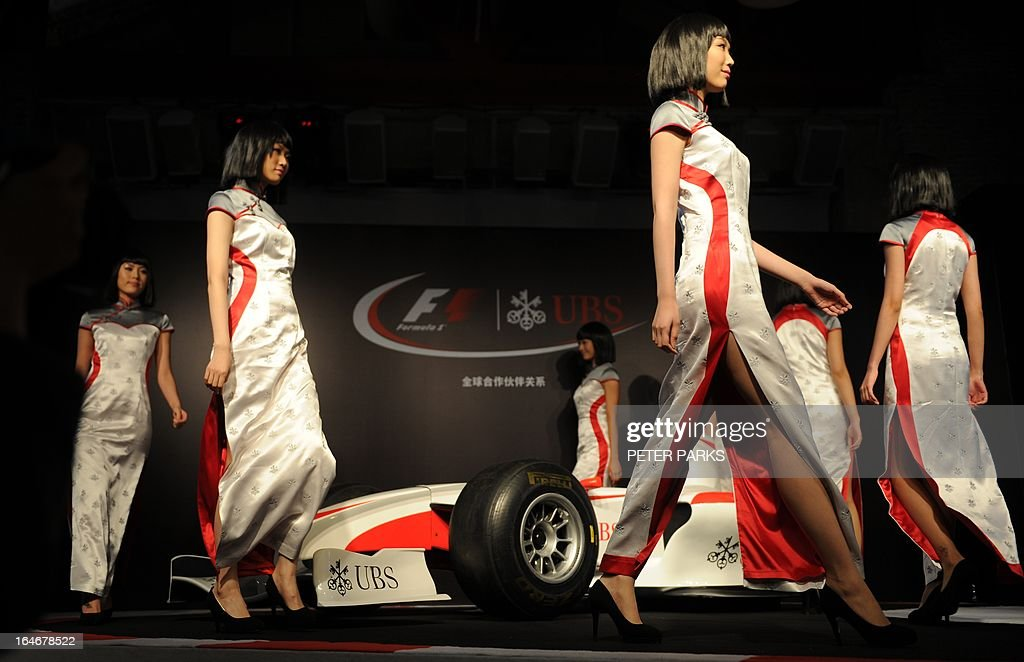 Grid girls show off new outfits designed by celebrated local designer Simon Wang ahead of the upcoming Formula One Chinese Grand Prix in Shanghai on March 26, 2013. The 10th Formula One Chinese Grand Prix will be held in Shanghai on April 14. AFP PHOTO/Peter PARKS