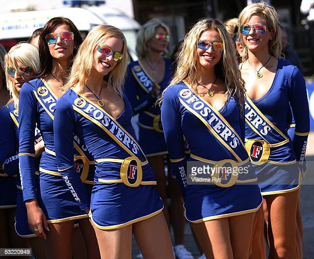 Grid girls smile on before the drivers parade of the British F1 Grand Prix on July 10 2005 in Silverstone England