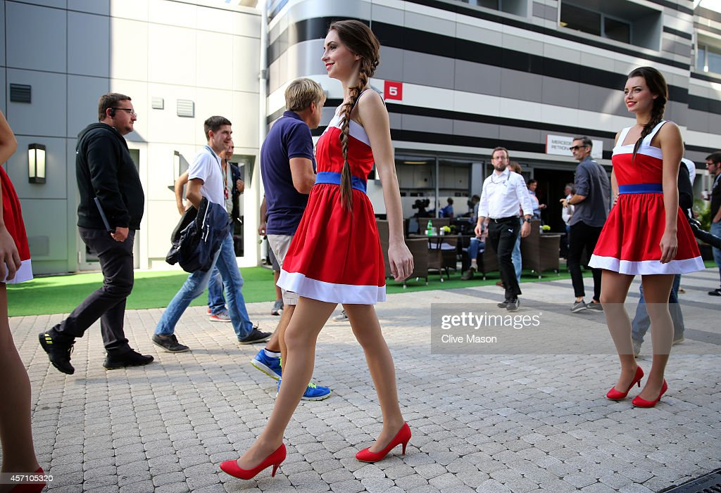 Grid girls walk along the paddock before the Russian Formula One Grand Prix at Sochi Autodrom on October 12 2014 in Sochi Russia