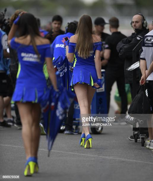 Grid girls walk the pit lane before the start of the MotoGP race of the Argentina Grand Prix at Termas de Rio Hondo circuit in Santiago del Estero...