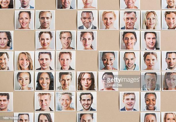 Grid of portrait prints, some gaps, random pattern