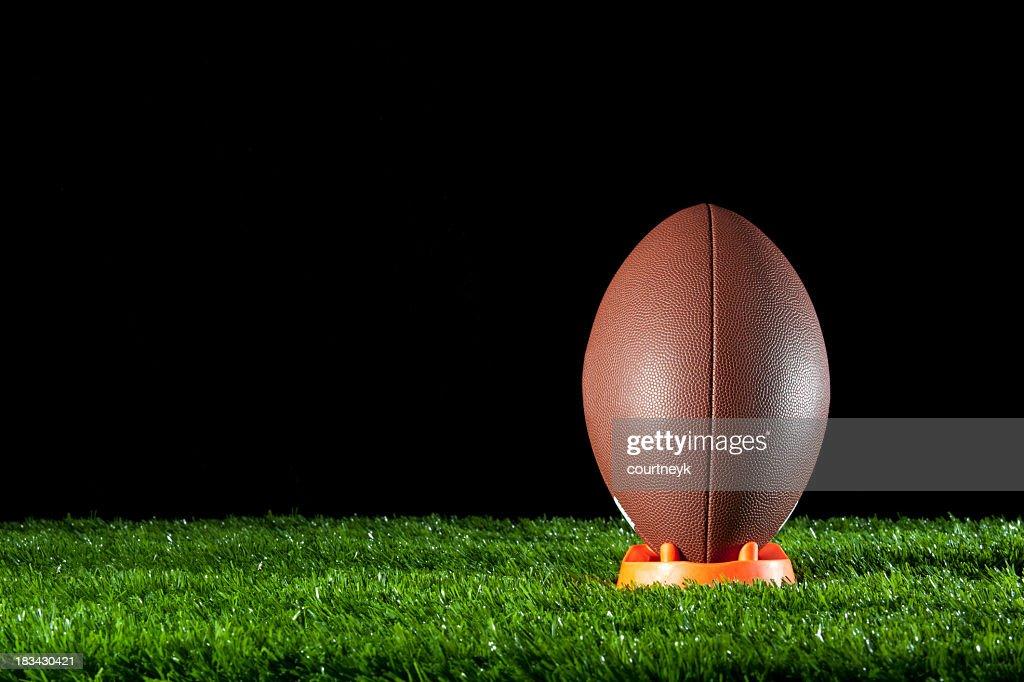 Gridiron ball standing on a tee