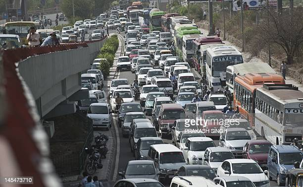 Gridlocked traffic caused by demonstrating Bharatiya Janata party activists blocking a road during a protest against a petrol price hike is pictured...