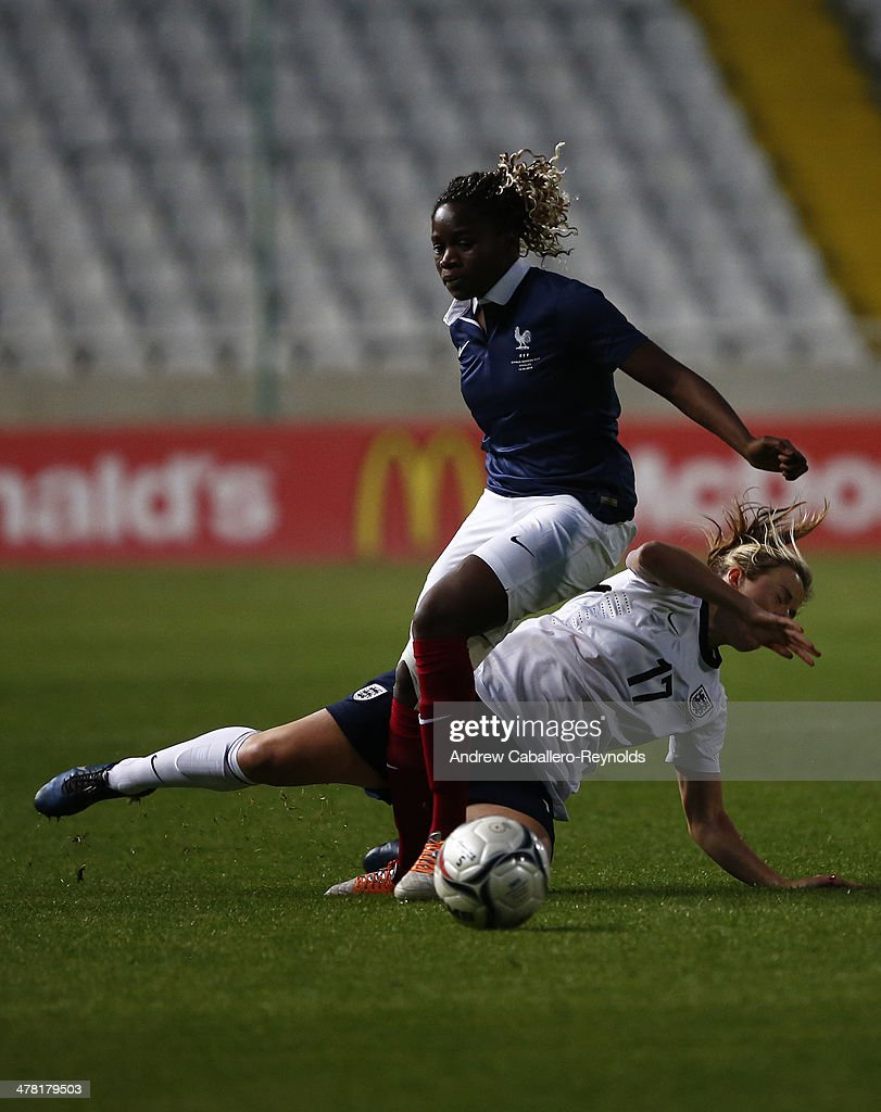 Griedge Mbock Bathy (top) of France and Gemma Davison of England in action during the Cyprus cup final between England an France at GSP stadium on March 12, 2014 in Nicosia, Cyprus.