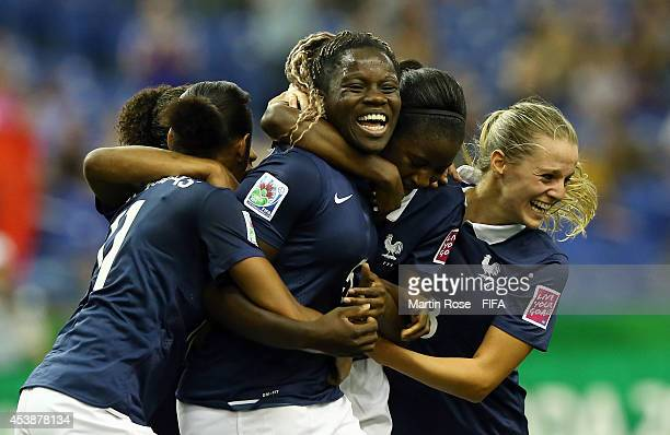 Griedge Mbock Bathy of France celebrate with her team mates after scoring the equalizing goal the ball during the FIFA U20 Women's World Cup 2014...