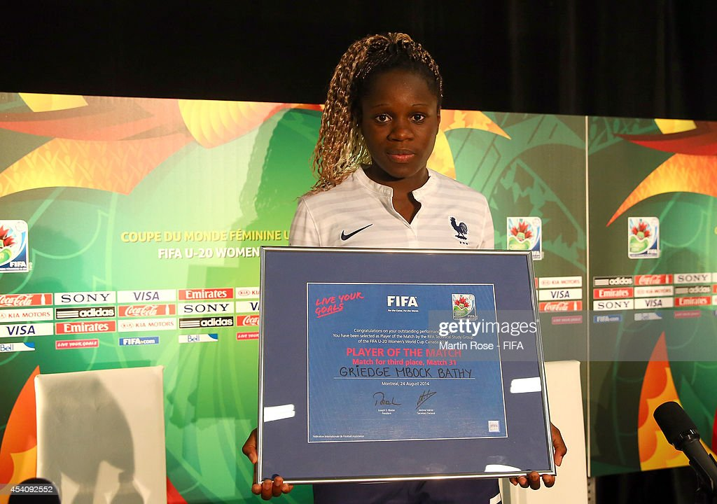 Griedge Mbock Bathy of France holds her Player of the Match framed certificate after the FIFA U-20 Women's World Cup 2014 3rd place playoff match between Korea DPR and France at Olympic Stadium on August 24, 2014 in Montreal, Canada.