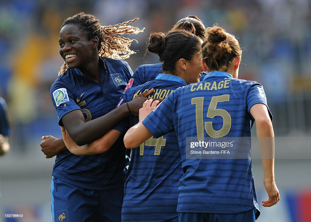 Griedge Mbock-Bathy (L) celebrates the goal scored by Diani Kadidiatou during the FIFA U-17 Women's World Cup 2012 Semi-Final match between France and Ghana at 8KM Stadium on October 9, 2012 in Baku, Azerbaijan.
