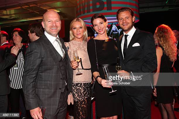CEO Gries Deco Company GmbH Christian Gries his wife Sandra Sophie Wepper and David Meister arrive at Tribute To Bambi 2014 at Station on September...