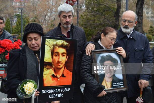 Grieved mothers mourn as they hold their sons' portraits during a commemoration to the 1st anniversary of the Guven Park bombing in Ankara Turkey on...