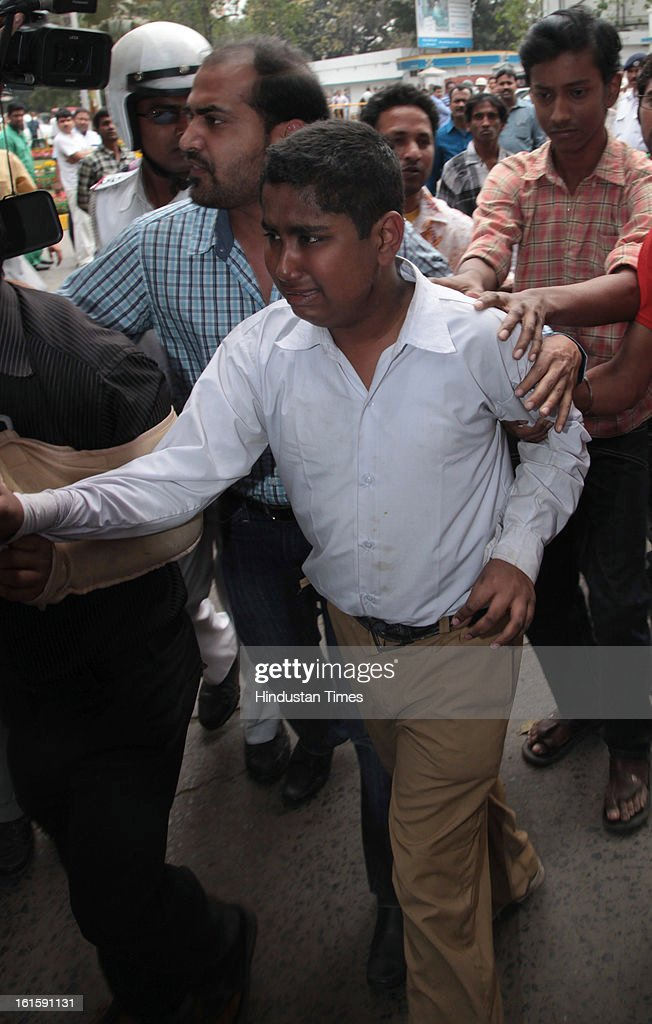 Grieved son of Sub Inspector Special Branch Tapas Choduhury who was shot dead while trying to control the clashing student activists of the of the Trinamool Congress and the Congress at Harimohan Ghose College in the Garden Reach area on February 12, 2013 in Kolkata, India.