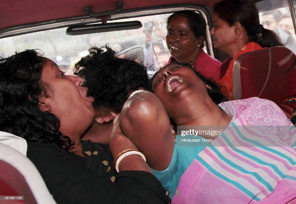 Grieved wife and family members of Sub Inspector Special Branch Tapas Choduhury who was shot dead while trying to control the clashing student activists of the of the Trinamool Congress and the Congress at Harimohan Ghose College in the Garden Reach area on February 12, 2013 in Kolkata, India.