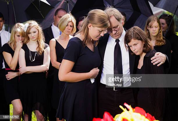Grieving Father and Daughters