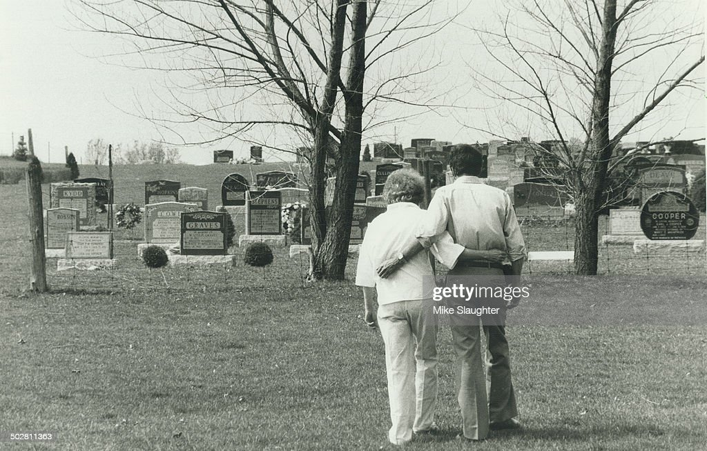 Grieving parents Robert and Janet Jessop walk sadly through Queensville cemetery today on their way to visit the grave of their slain daughter...