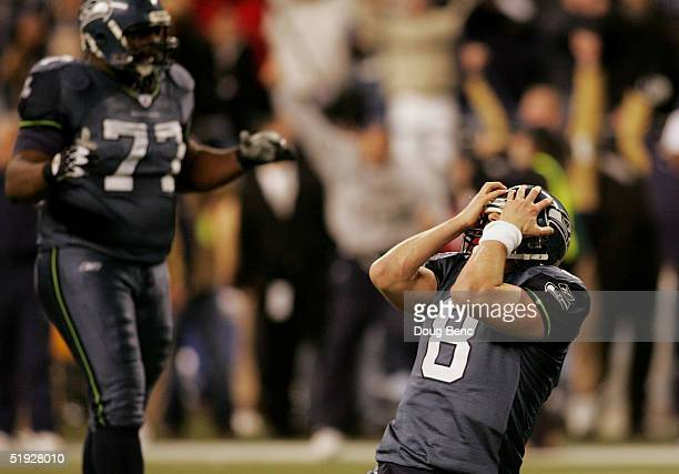 Grieving quarterback Matt Hasselbeck of the Seattle Seahawks holds his head after throwing an incomplete pass into the endzone on their final...
