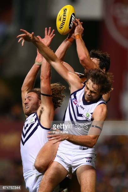 Griffin Logue and Joel Hamling of the Dockers contest for a mark against Josh Kennedy of the Eagles during the round six AFL match between the West...