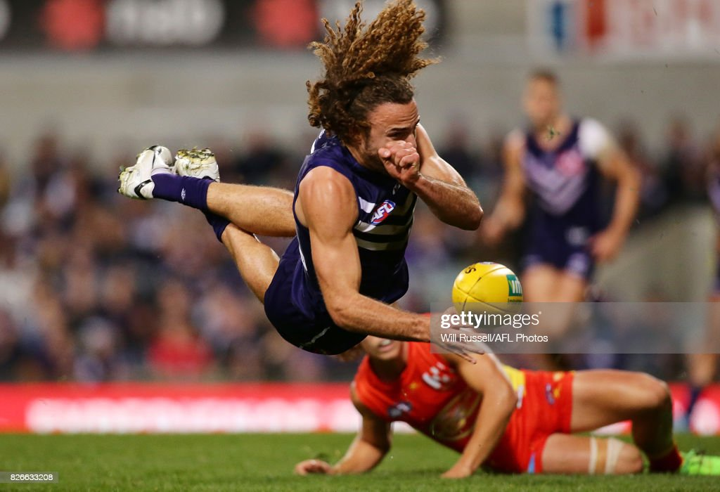 Griffin Logue of the Dockers handpasses the ball during the round 20 AFL match between the Fremantle Dockers and the Gold Coast Suns at Domain Stadium on August 5, 2017 in Perth, Australia.