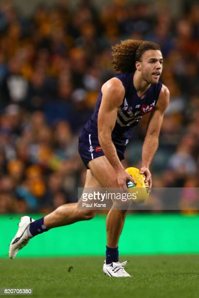 Griffin Logue of the Dockers looks to pass the ball during the round 18 AFL match between the Fremantle Dockers and the Hawthorn Hawks at Domain...