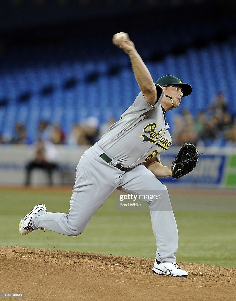 A.J. Griffin #64 of the Oakland Athletics delivers a pitch during MLB game action against the Toronto Blue Jays July 25, 2012 at Rogers Centre in Toronto, Ontario, Canada.