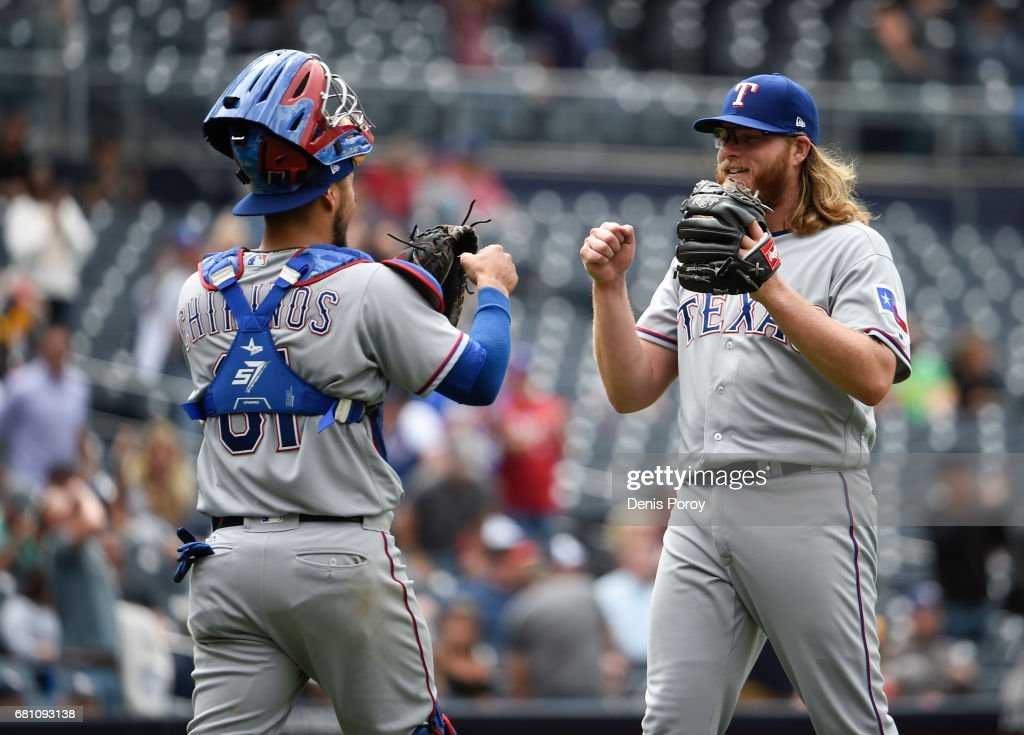 A.J. Griffin #64 of the Texas Rangers, right, is congratulated by Robinson Chirinos #61 after beating the San Diego Padres 11-0 in a baseball game at PETCO Park on May 9, 2017 in San Diego, California.