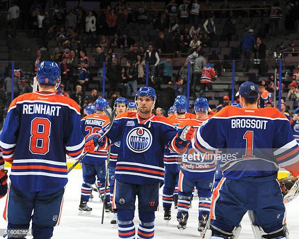 Griffin Reinhart Andrej Sekera and Laurent Brossoit of the Edmonton Oilers celebrate after winning the game against the St Louis Blues on March 16...