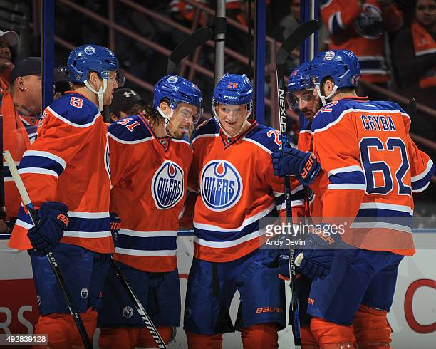Griffin Reinhart Anton Lander Lauri Korpikoski Teddy Purcell and Eric Gryba of the Edmonton Oilers celebrate after a goal during a game against the...
