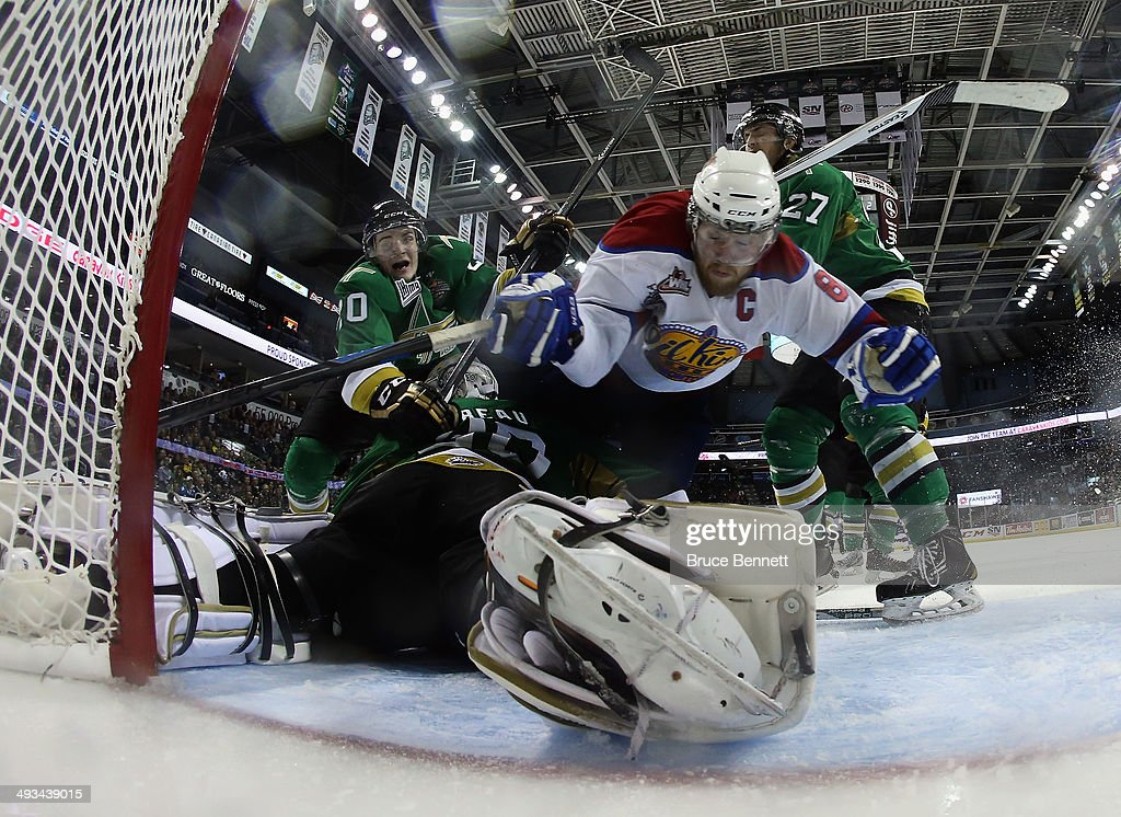 Griffin Reinhart #8 of the Edmonton Oil Kings is launched over Antoine Bibeau #30 of the Val-d'Or Foreurs during the second period during the 2014 Memorial Cup tournament at Budweiser Gardens on May 23, 2014 in London, Ontario, Canada.