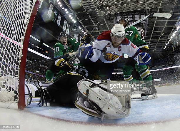 Griffin Reinhart of the Edmonton Oil Kings is launched over Antoine Bibeau of the Vald'Or Foreurs during the second period during the 2014 Memorial...