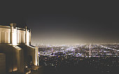 Griffith Observatory at night with a view of Financial District