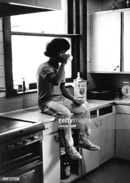 Griffiths Emily Boys Home Before starting his cleaning duties a Griffith Home resident eats a quick breakfast while sitting on kitchen counter The...
