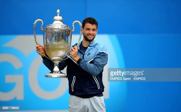 Grigor Dimitrov celebrates with the trophy after defeating Feliciano Lopez in the final