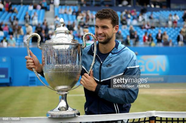 Grigor Dimitrov celebrates with the trophy after defeating Feliciano Lopez
