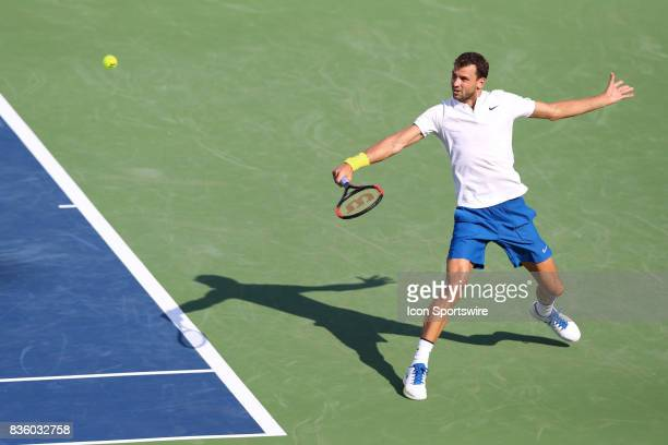 Grigor Dimitrov hits a backhand during the championship match against Nick Kyrgios during the Western Southern Open at the Lindner Family Tennis...
