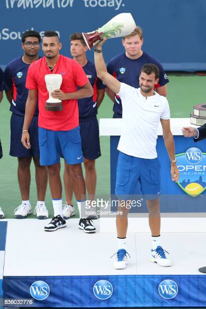 Grigor Dimitrov holds up his trophy after the championship match against Nick Kyrgios during the Western Southern Open at the Lindner Family Tennis...