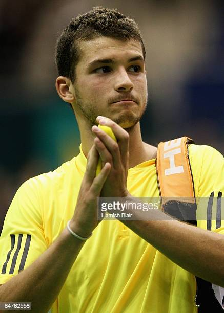 Grigor Dimitrov of Bulgaria acknowledges the crowd after defeat in his match against Rafael Nadal of Spain during day four of the ABN AMRO World...