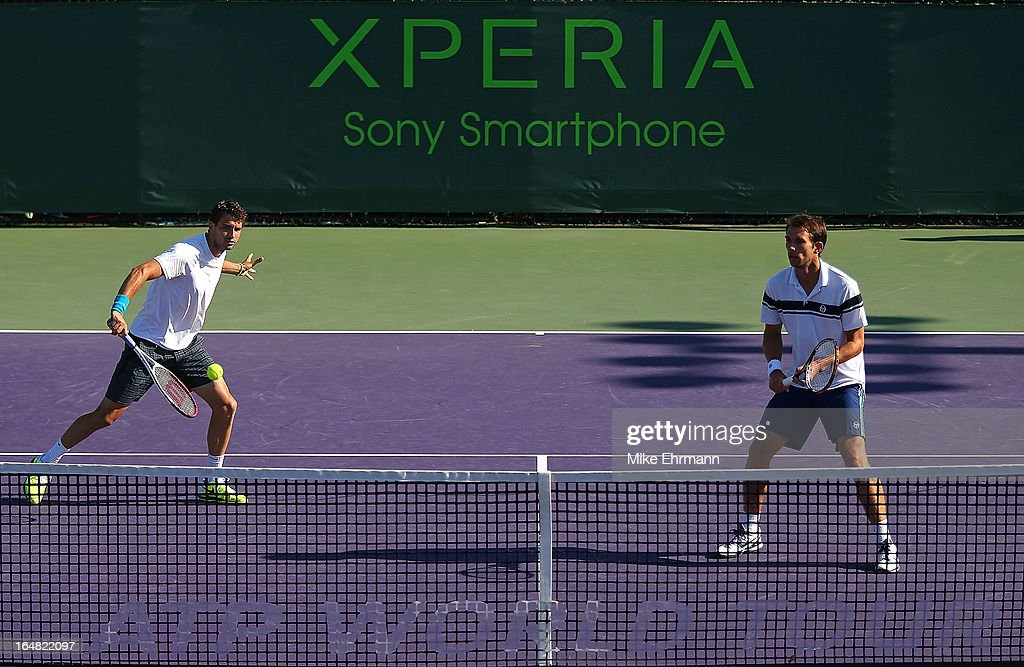 Grigor Dimitrov of Bulgaria and Frederik Nielsen of Denmark play a doubles match against Tommy Haas of Germany and Xavier Malisse of Belgium during...
