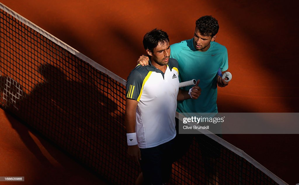 Grigor Dimitrov of Bulgaria at the net after his straight set victory as he consoles Marcos Baghdatis of Cyprus after their first round match during day one of the Internazionali BNL d'Italia 2013 at the Foro Italico Tennis Centre on May 12, 2013 in Rome, Italy.