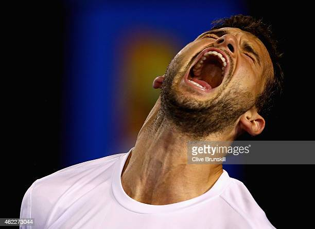 Grigor Dimitrov of Bulgaria celebrates a point in the second set in his fourth round match against Andy Murray of Great Britain during day seven of...