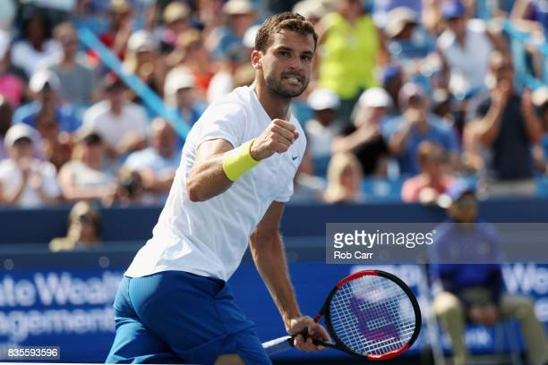 Grigor Dimitrov of Bulgaria celebrates after defeating John Isner to advance to the finals during Day 8 of the Western and Southern Open at the...