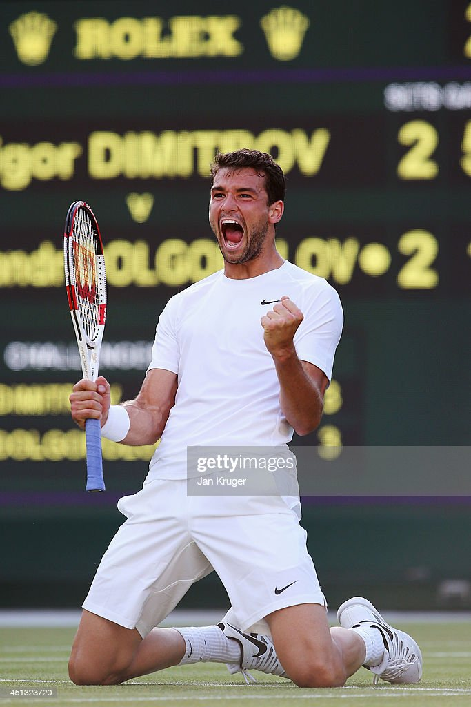 <a gi-track='captionPersonalityLinkClicked' href=/galleries/search?phrase=Grigor+Dimitrov&family=editorial&specificpeople=4332557 ng-click='$event.stopPropagation()'>Grigor Dimitrov</a> of Bulgaria celebrates after winning his Gentlemen's Singles third round match against Alexandr Dolgopolov of Ukraine on day five of the Wimbledon Lawn Tennis Championships at the All England Lawn Tennis and Croquet Club on June 27, 2014 in London, England.