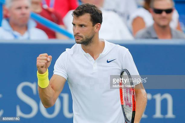 Grigor Dimitrov of Bulgaria celebrates against Nick Kyrgios of Austrailia in the men's final on Day 9 of the Western and Southern Open at the Linder...