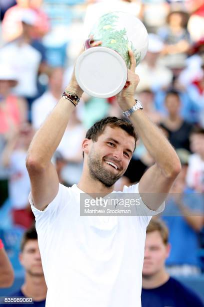 Grigor Dimitrov of Bulgaria celebrates his win over Nick Kyrgios of Australia during the men's final on day 9 of the Western Southern Open at the...