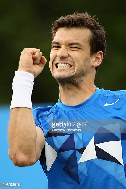 Grigor Dimitrov of Bulgaria celebrates match point during his mens singles first round match against Gilles Muller of Luxembourg on day three of the...