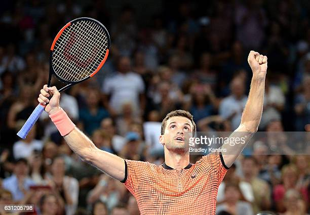 Grigor Dimitrov of Bulgaria celebrates victory against Kei Nishikori of Japan after the Men's Final on day eight of the 2017 Brisbane International...