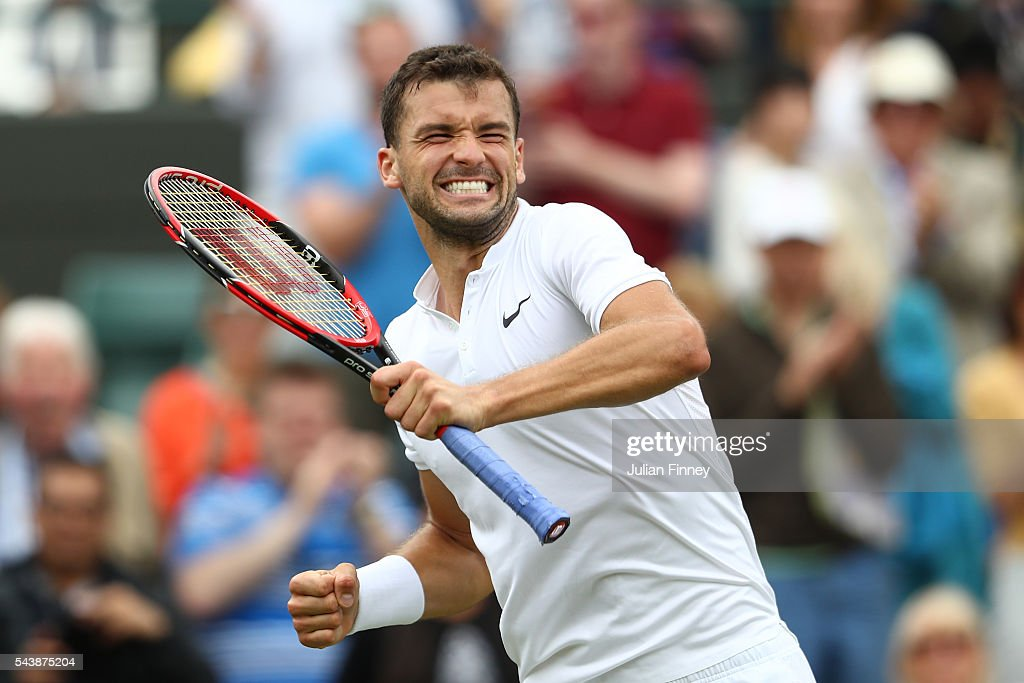 <a gi-track='captionPersonalityLinkClicked' href=/galleries/search?phrase=Grigor+Dimitrov&family=editorial&specificpeople=4332557 ng-click='$event.stopPropagation()'>Grigor Dimitrov</a> of Bulgaria celebrates victory during the Men's Singles second round match against Gilles Simon of France on day four of the Wimbledon Lawn Tennis Championships at the All England Lawn Tennis and Croquet Club on June 30, 2016 in London, England.