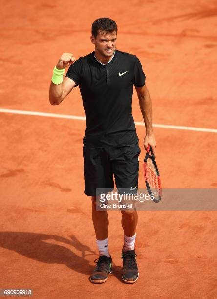 Grigor Dimitrov of Bulgaria celebrates victory following the mens singles second round match against Tommy Robredo of Spain on day four of the 2017...