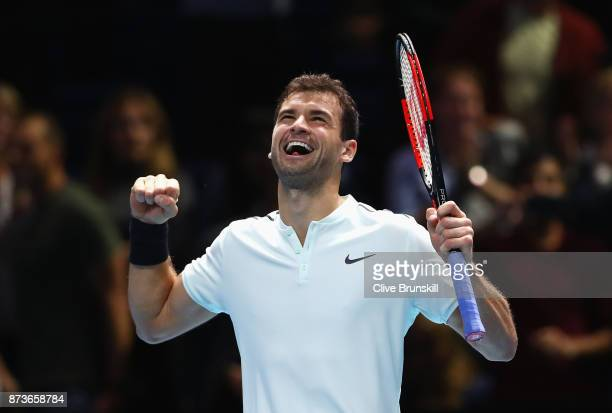 Grigor Dimitrov of Bulgaria celebrates victory in his Singles match against Dominic Thiem of Austria during day two of the Nitto ATP World Tour...