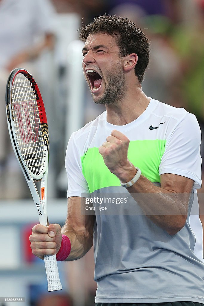 Grigor Dimitrov of Bulgaria celebrates winning his semi final match against Marcos Baghdatis of Cyprus on day seven of the Brisbane International at Pat Rafter Arena on January 5, 2013 in Brisbane, Australia.
