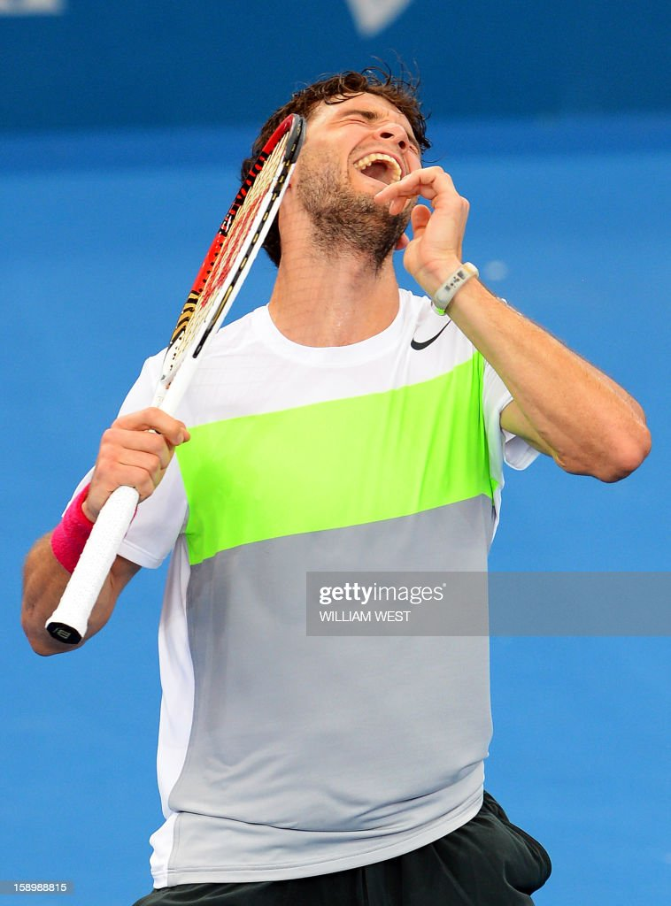 Grigor Dimitrov of Bulgaria celebrates winning his semi-final match against Marcos Baghdatis of Cyprus at the Brisbane International tennis tournament, on January 5, 2013. AFP PHOTO/William WEST IMAGE RESTRICTED TO EDITORIAL USE - STRICTLY NO COMMERCIAL USE